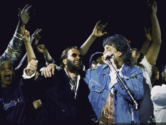 former-beatles-ringo-starr-and-paul-mccartney-performing