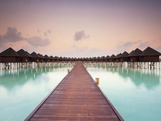 frank-lukasseck-boardwalk-and-water-bungalows-after-sunset