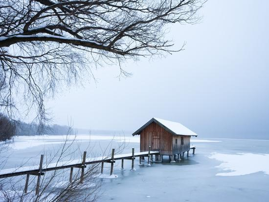 frank-lukasseck-snow-covered-pier-and-boat-house-at-lake-starnberg