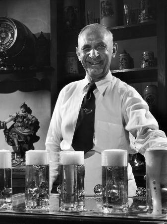 frank-scherschel-bartender-smiling-as-he-serves-large-glasses-of-beer