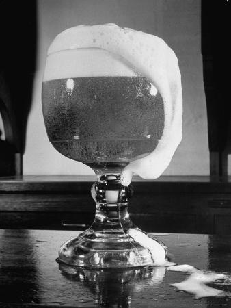 frank-scherschel-fancy-glass-overflowing-with-beer