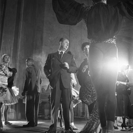 frank-scherschel-french-designer-christian-dior-adjusting-a-leopard-print-fabric-on-a-dancer-paris-november-1947