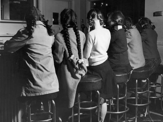 frank-scherschel-girls-known-as-pigtailers-sitting-on-stools-at-soda-fountain