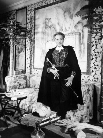 frank-scherschel-poet-and-filmmaker-jean-cocteau-dressed-in-uniform-of-academie-francaise-holding-sword-he-designed