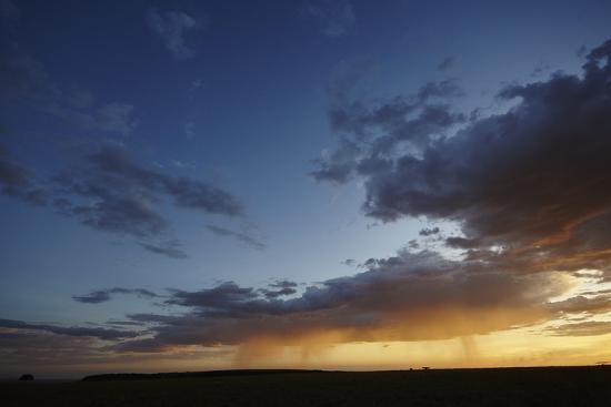 frederic-courbet-rain-and-sunset-on-the-maasai-mara-plains-kenya-east-africa-africa