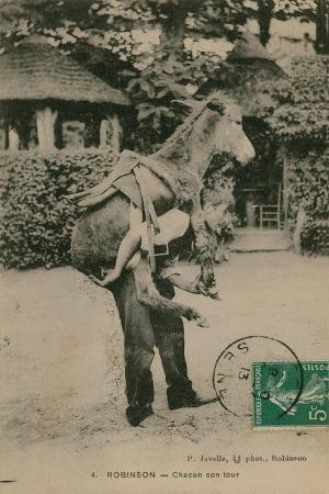 french-photographer-postcard-of-a-man-carrying-a-donkey-sent-in-1913
