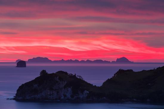 garry-ridsdale-the-sky-appears-on-fire-as-dawn-light-seeps-through-clouds-beyond-alderman-island