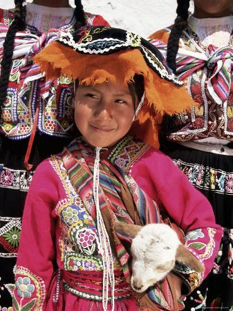 gavin-hellier-portrait-of-a-local-smiling-peruvian-girl-in-traditional-dress-holding-a-young-animal-cuzco-peru