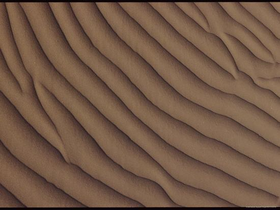 george-f-mobley-a-close-up-of-a-sand-dune-showing-a-rippling-effect-caused-by-the-wind