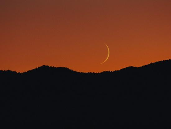 george-f-mobley-a-crescent-moon-sets-over-mountains-rimming-the-western-edge-of-lake-tahoe
