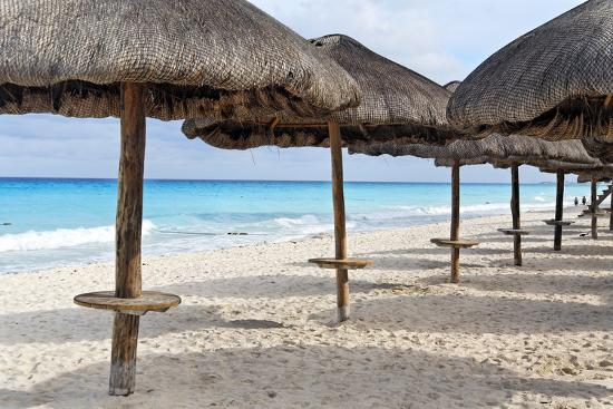 george-oze-palapas-lined-up-on-the-beach-cancun-mexico