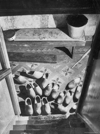 george-rodger-wooden-shoes-in-a-hallway-at-the-bottom-of-the-stairs