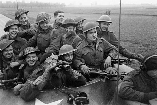 george-silk-members-of-the-british-49th-armoured-personnel-carrier-regiment-riding-along-a-line-of-tanks