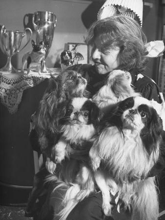 george-silk-woman-playing-with-her-dogs-in-her-apartment