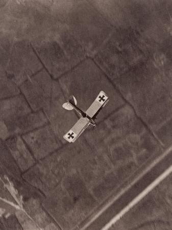 german-aviatik-plane-photographed-in-mid-air-by-a-belgian-reconnaisance-aircraft-over-holland