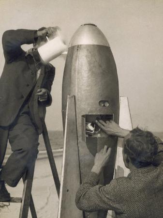 german-rocket-experiments-on-a-windswept-spit-of-land-filling-the-device-with-its-chemical-fuel