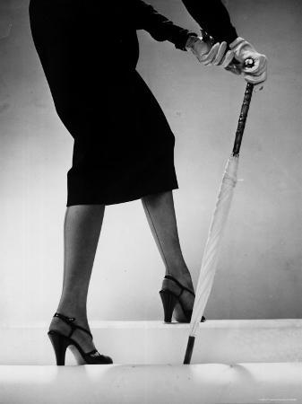 gjon-mili-model-wearing-tight-skirt-and-stripped-patent-sandals-with-new-heelless-stockings