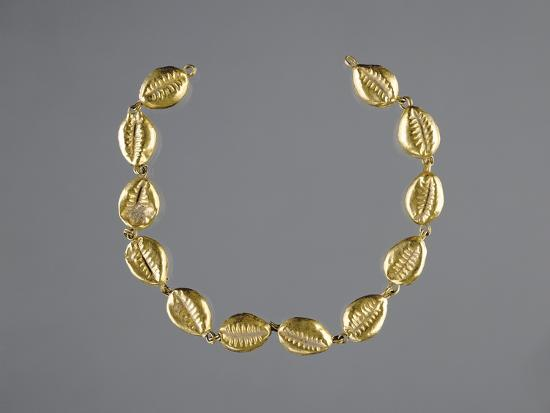 gold-beads-in-the-shape-of-cowrie-shells