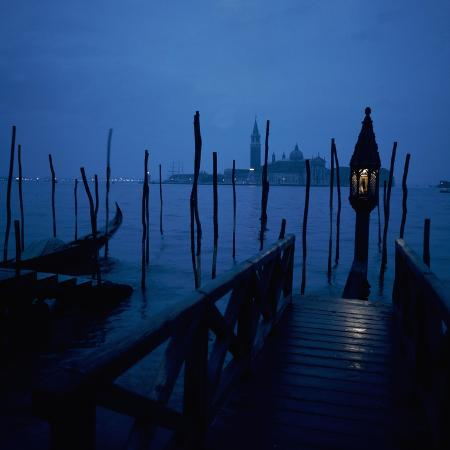 gondola-moorings-and-the-eternal-light-with-san-giorgio-maggiore-in-the-background