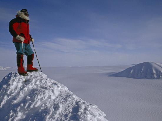 gordon-wiltsie-polar-explorer-stands-atop-nemtinov-peak-surrounded-by-glaciers