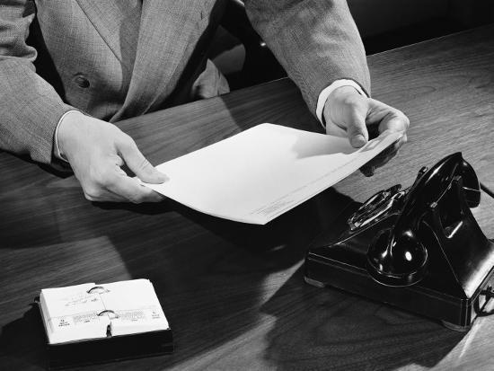 hand-shot-of-man-holding-document