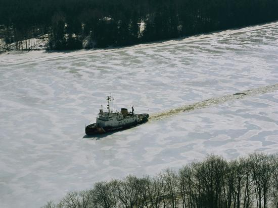 heather-perry-a-u-s-coast-guard-boat-breaks-its-way-through-the-icy-river