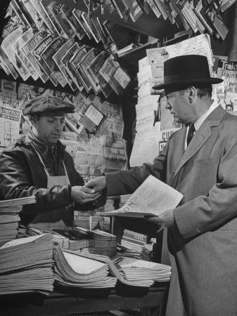herbert-gehr-milton-w-holden-of-bull-holden-and-co-buying-paper-from-the-famous-morris-the-newsboy