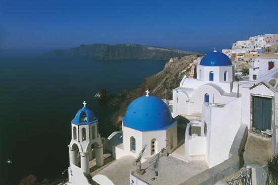 high-angle-view-of-a-church-in-a-town-oia-santorini-cyclades-islands-southern-aegean-greece