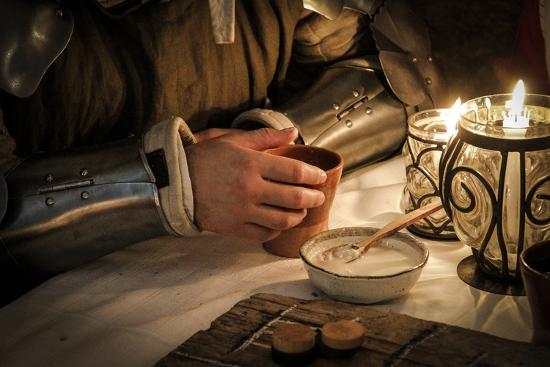 historical-reenactment-soldier-at-table-in-tavern-14th-century