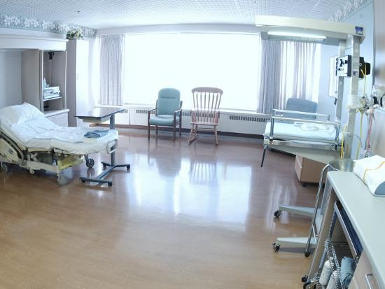 hospital-bed-chairs-and-medical-equipment-arranged-in-empty-hospital-room