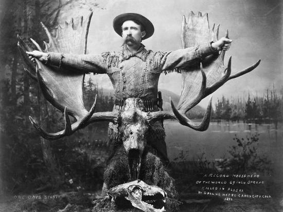 hunter-with-record-moose-antlers