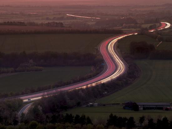 ian-egner-telephoto-aerial-view-of-light-trails-at-dusk-on-m40-motorway-in-chilterns-oxfordshire-england