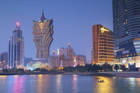 ian-trower-grand-lisboa-and-wynn-hotel-and-casino-at-dusk-macau-china-asia