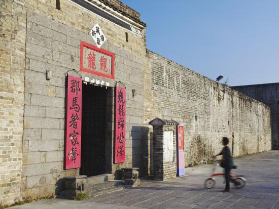 ian-trower-woman-entering-san-wai-walled-village-fanling-new-territories-hong-kong-china