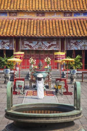 ian-trower-woman-wearing-ao-dai-dress-at-mieu-temple-inside-citadel-hue-thua-thien-hue-vietnam-indochina