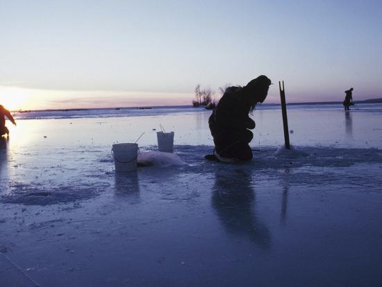 ice-fishing-at-sunset-canada