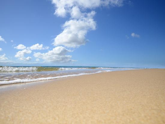 idizimage-soft-wave-of-the-sea-on-the-sandy-beach