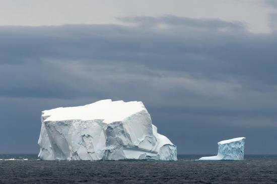 inger-hogstrom-antarctica-bransfield-strait-iceberg-under-stormy-skies