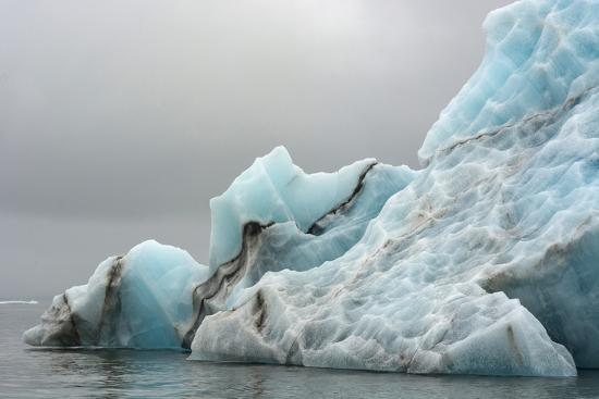 inger-hogstrom-norway-svalbard-spitsbergen-brepollen-iceberg-with-moraine-dust