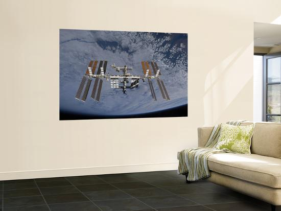 international-space-station-set-against-the-background-of-a-cloud-covered-earth
