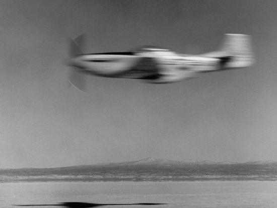 j-r-eyerman-airplane-in-flight-speed-blurred