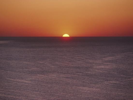 james-l-stanfield-a-brillant-orange-sun-dips-behind-the-mediterranean-sea