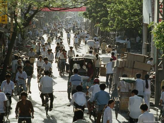 james-l-stanfield-cyclists-and-pedestrians-on-a-busy-guangzhou-street-china