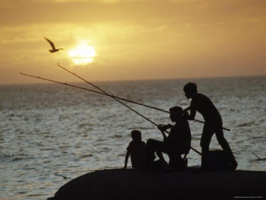 james-l-stanfield-silhouetted-people-fish-from-the-shoreline-near-montevideo-montevideo-uruguay