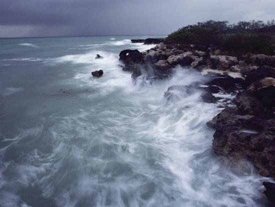 james-l-stanfield-surf-lashes-a-rocky-shore