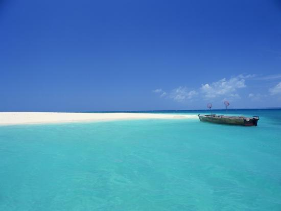 james-mitchell-boat-at-tropical-beach