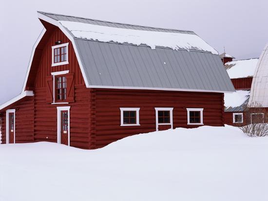 james-randklev-red-barn-in-the-snow