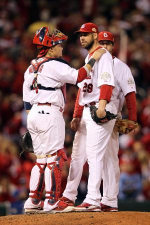 jamie-squire-game-7-rangers-v-cardinals-st-louis-mo-october-28-chris-carpenter-and-yadier-molina