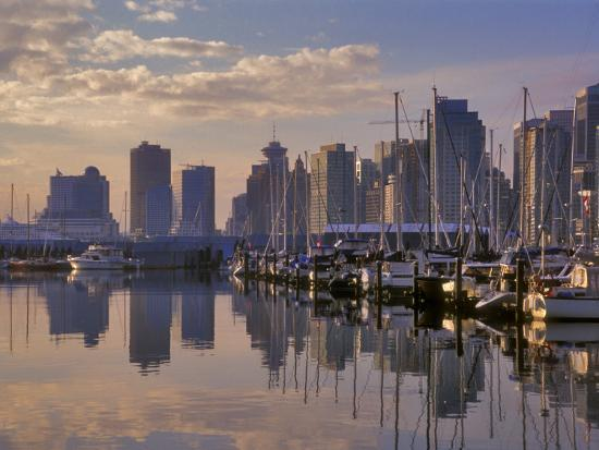 janis-miglavs-vancouver-skyline-with-boats-in-harbor-at-sunrise-seen-from-stanley-park-british-columbia-canada
