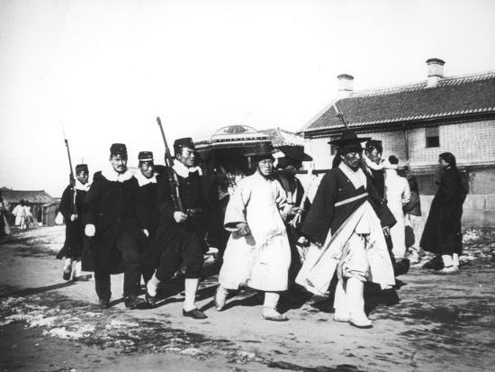 japanese-official-with-an-escort-of-soldiers-korea-c1900